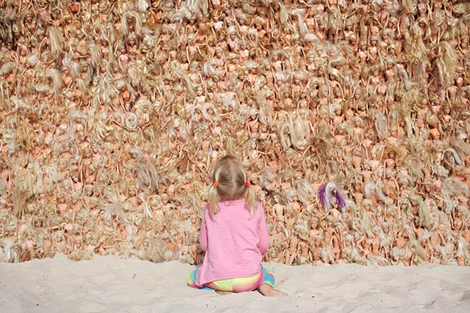 the barbie wave towers over the child photo by jarred seng / courtesy of sculpture by the sea