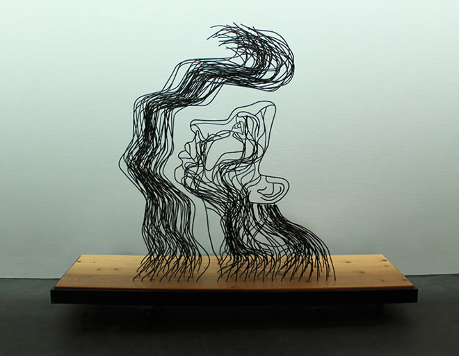 Gavin Worth - Wire Sculpture - And Light Fell On Her Face Through Heavy Darkness - Steel rods and cedar wood, 96x72x30