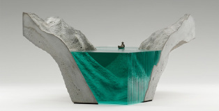 Ben Young - Glass sculptures, The entrance, Laminated clear float glass with cast concrete base and cast white bronze canoe.