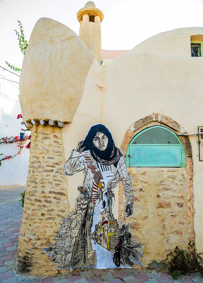 Il villaggio della street art in Tunisia, a mural by swoon