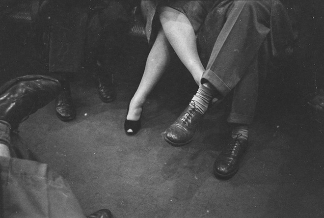 The New York subway, by Stanley Kubrick. Stanley Kubrick. Life and Love on the New York City Subway. Couple playing footsies on a subway. 1946. Museum of the City of New York. X2011.4.10292.90E