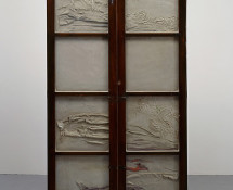 Doris Salcedo - Untitled, 1998. Wooden cabinet, concrete, steel, and clothing, 72 1/4 x 39 x 13 in. (183.5 x 99.5 x 33 cm). Collection of Lisa and John Miller, fractional and promised gift to the San Francisco Museum of Modern Art. Photo: David Heald. Reproduced courtesy of the artist; Alexander and Bonin, New York; and White Cube, London.