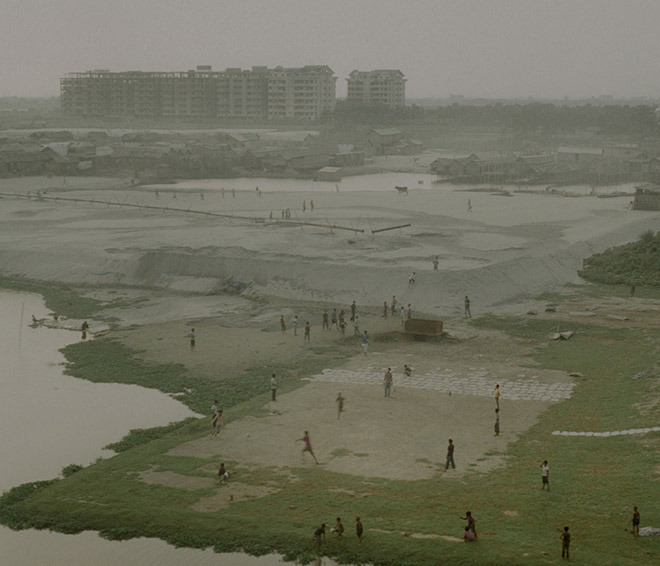 "Rasel Chowdhury, ""Urban structures growing up on the middle of the river, Hazari Bag, Dhaka"" (from the series 'Desperate Urbanization') (2010–2014)"