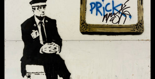 Banksy - Gallery Attendant AKA Prick, 2004 - Spray Paint and Stencil on Plywood, 95 x 95 inches - Original street work