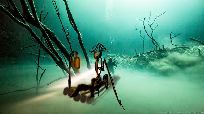 Benjamin Von Wong - Underwater River, Portrait of a Cormorant Fisherman 30m Underwater