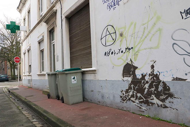 Banksy - Calais Town centre,  We're not all in the same boat.