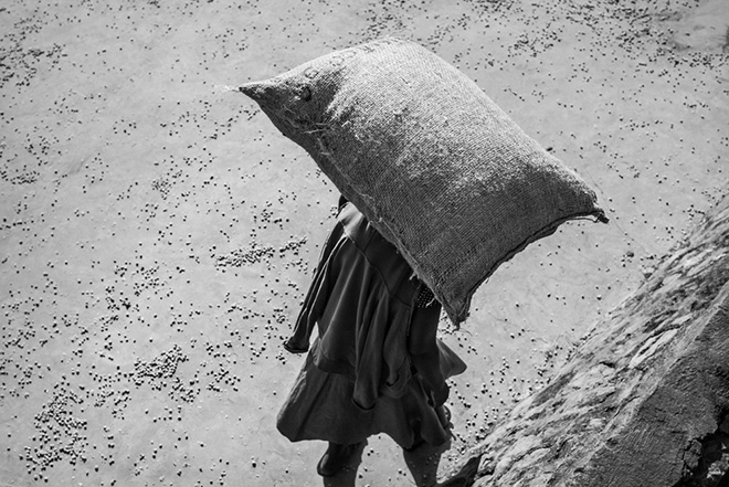 ©Jakob de Boer - Origin, Woman Carrying 35 Kilos of Coffee, Tanzania 2015, Selenium toned, gelatin silver print.