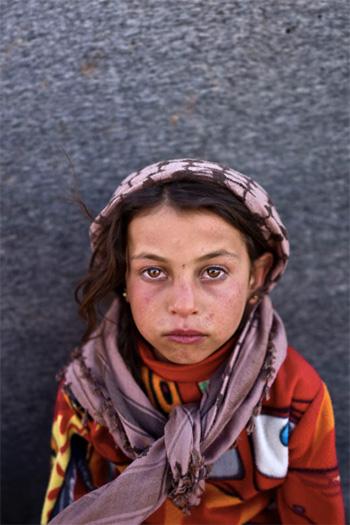 Muhammed Muheisen / AP Photo - Hanan Khalid, 7 anni,  viene da Hassakeh, Siria. La foto è stata scattata il 12 marzo in un campo profughi vicino al confine siriano nella periferia di Mafraq, Giordania.