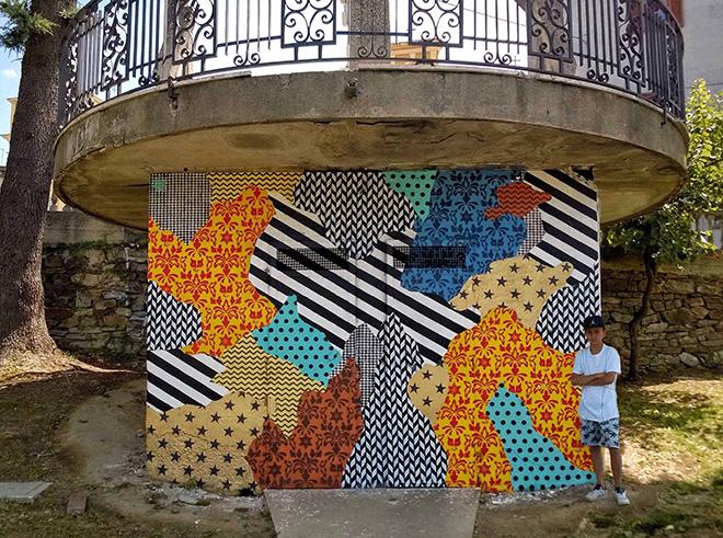 UNO street art - Camouflage 87054, murale a Rogliano (Cosenza), per Gulia Urbana Festival 2016. Model: Gianmaria aka Ria