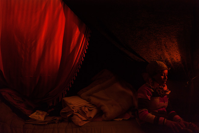 Yiorgios Doukanaris, Home, Calais, France, 2015. An Eritrean refugee woman sitting in her tent in the refugee camp of Calais, France.