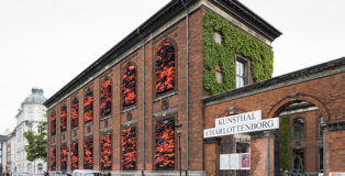 """Ai Weiwei - """"Soleil Levant"""", 2017. Installation view, Kunsthal Charlottenborg, 2017. Life jackets in front of windows of facade. Courtesy of the artist. Photo by David Stjernholm."""
