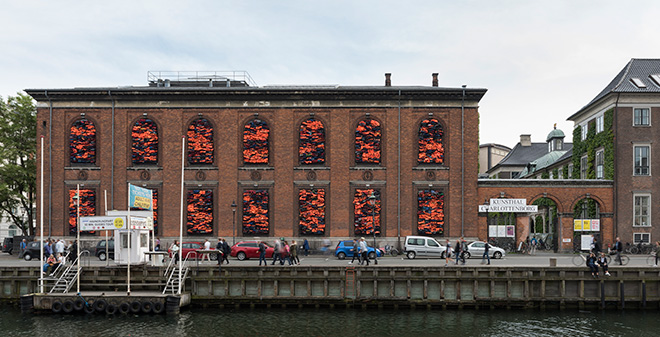 Ai Weiwei - Soleil Levant, 2017. Installation view, Kunsthal Charlottenborg, 2017. Life jackets in front of windows of facade. Courtesy of the artist. Photo by David Stjernholm.