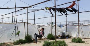 Valerio Muscella - Bambino siriano in un accampamento vicino Gaziantep