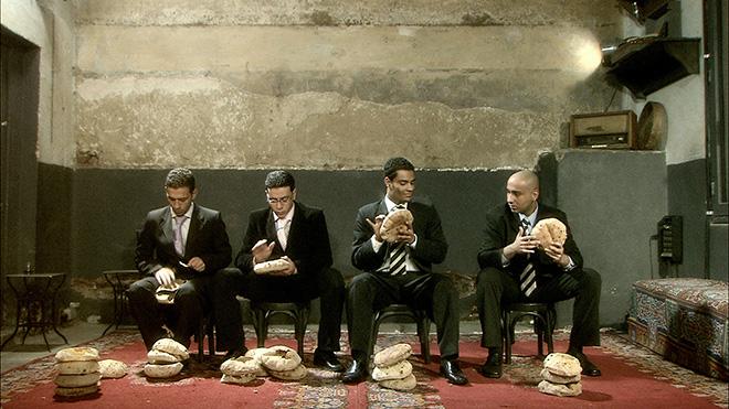 Adel Abidin - Bread of Life, 2008, video installazione. Photo Credits Martin Jager, Courtesy Adel Abidin