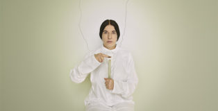 Marina Abramović, Artist Portrait with a Candle (C) dalla serie Places of Power, 2013, Courtesy of Marina Abramović Archives© Marina Abramović by SIAE 2018.