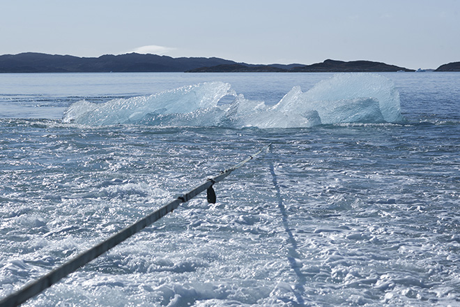 Harvesting ice floating in Nuup Kangerlua, Greenland, for Ice Watch in Paris, 2015. Photo: Jørgen Chemnitz