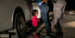 "World Press Photo of the Year, Winner - Crying Girl on the Border"" © John Moore, Getty Images Immigrant families had rafted across the Rio Grande from Mexico and were detained by the authorities. Yana (who was approaching her second birthday) and her mother had been part of a refugee caravan that started its journey in southern Mexico in April. Yana, from Honduras, cries as her mother Sandra Sanchez is searched by a US Border Patrol agent, in McAllen, Texas, USA, on 12 June."
