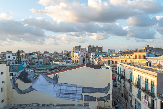 JR - GIANTS peeking at the city, Havana, Cuba, 2019. Ph. Nestor Kim. Courtesy: the artist and GALLERIA CONTINUA, San Gimignano / Beijing / Les Moulins / Habana