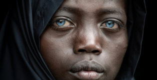© Trevor Cole, Ireland - Abushe from the series Tribal traits and traditions in Africa, 1st place winner AAP Magazine 10 Portrait. Abushe is a young boy of the Ari tribe who lives on the streets of Jinka in the Omo Valley of Ethiopia. He has cornflower blue eyes as a result of a genetic mutation.