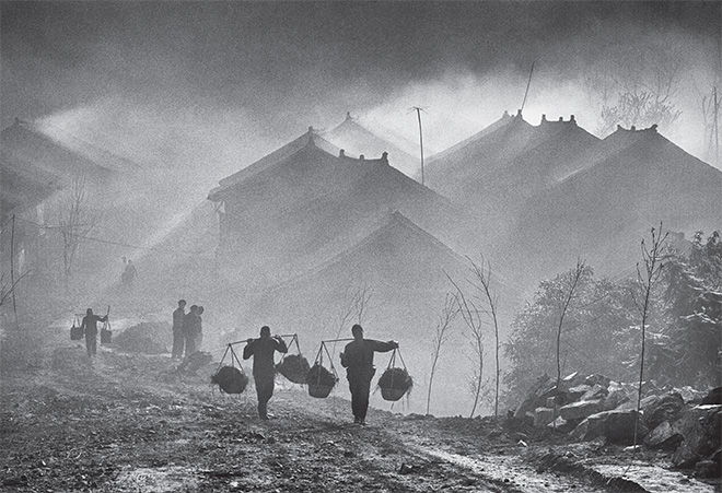 ©Philippe Fatin - In the Mounts of the Moon (series). Misty morning at Baojin village in winter time, Guizhou province, Zhenyuan district China.