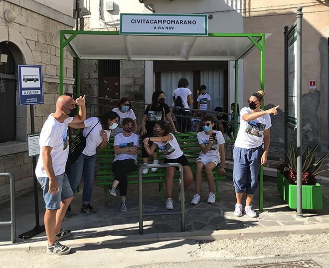 Biancoshock - (A Via Nov), Cvtà Street Fest 2020, Civitacampomarano. Photo credit: Giorgio Coen Cagli. People from Civita are finally waiting for the bus at the bus-stop created by Biancoshock. It was removed in 2011, without being replaced by a new one.