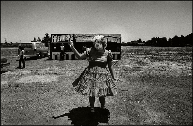 Saul Bromberger - Fireworks Booth at The Fourth of July  Fremont, CA 1981. © Saul Bromberger/All About Photo